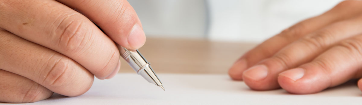 close up photo of patient signing forms Colorado Allergy & Asthma Centers
