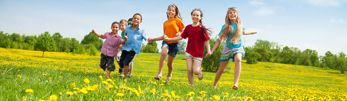 a group of children run through a field of flowers on a sunny day Colorado Allergy & Asthma Centers