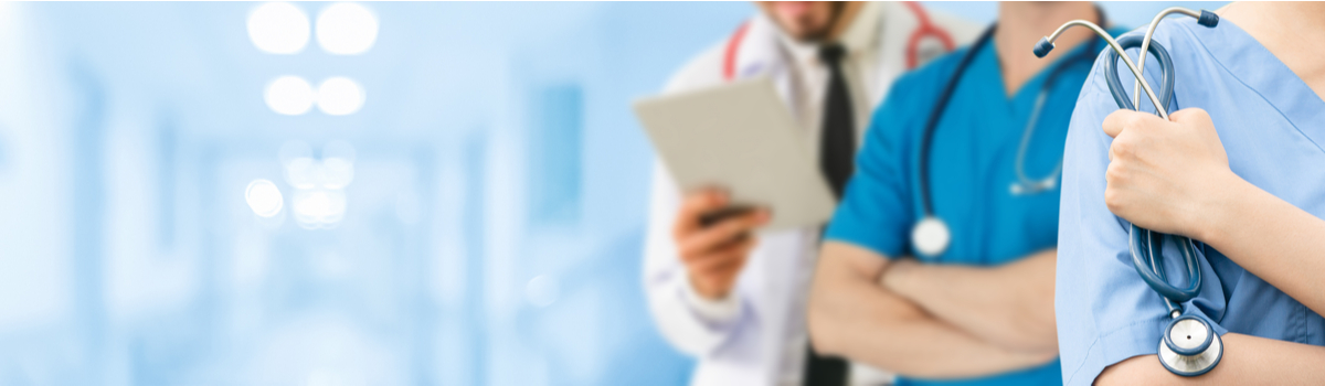 three health care providers with stethoscopes in hospital setting Colorado Allergy & Asthma Centers